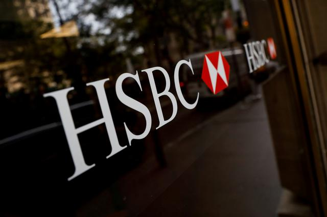 FILE PHOTO: HSBC logos are seen on a branch bank in the financial district in New York, U.S., August 7, 2019. REUTERS/Brendan McDermid/File Photo