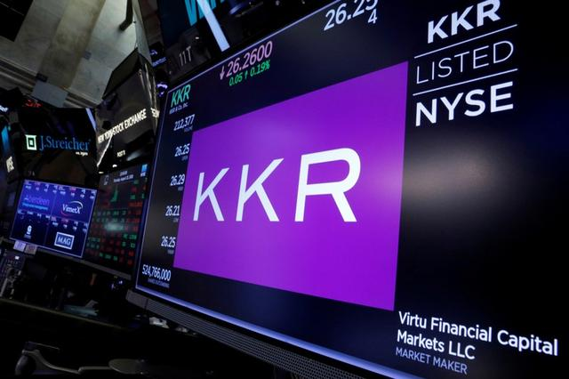 FILE PHOTO: The KKR & Co name is displayed on a screen on the floor of the New York Stock Exchange (NYSE) in New York, U.S., August 23, 2018. REUTERS/Brendan McDermid/File Photo