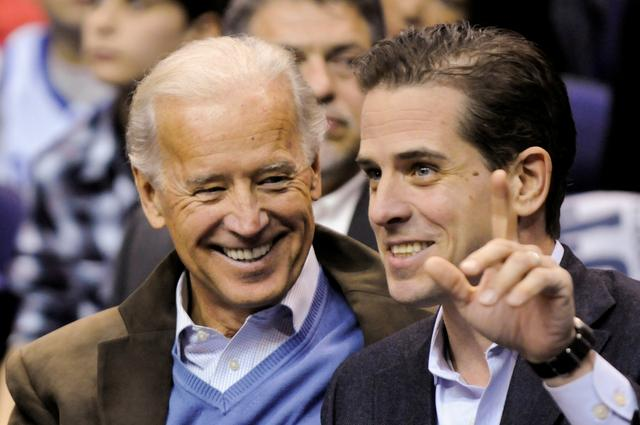 FILE PHOTO: U.S. Vice President Joe Biden and his son Hunter Biden attend an NCAA basketball game between Georgetown University and Duke University in Washington, U.S., January 30, 2010. REUTERS/Jonathan Ernst