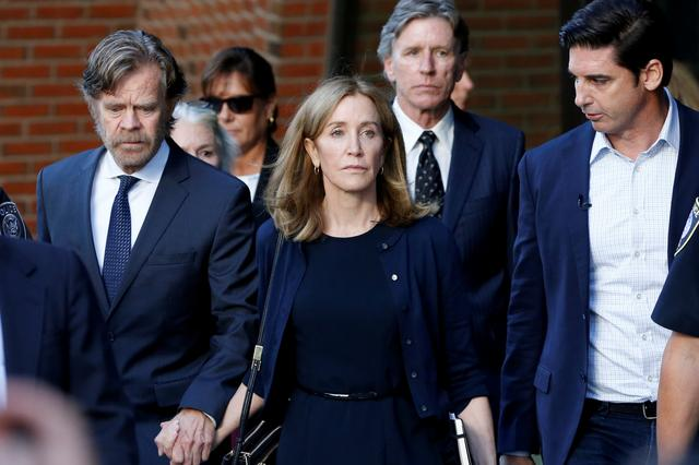 FILE PHOTO: Actress Felicity Huffman leaves the federal courthouse with her husband William H. Macy after being sentenced in connection with a nationwide college admissions cheating scheme in Boston, Massachusetts, U.S., September 13, 2019.  REUTERS/Katherine Taylor/File Photo