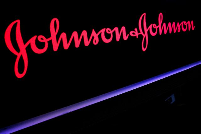 FILE PHOTO: The Johnson & Johnson logo is displayed on a screen on the floor of the New York Stock Exchange (NYSE) in New York, U.S., May 29, 2019. REUTERS/Brendan McDermid/File Photo