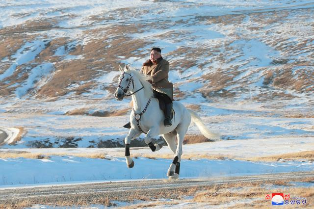 North Korean leader Kim Jong Un rides a horse during snowfall in Mount Paektu in this image released by North Korea's Korean Central News Agency (KCNA) on October 16, 2019. KCNA via REUTERS