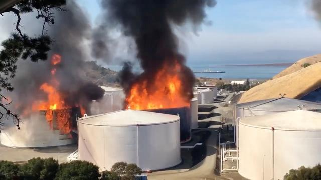 Smoke billows from fire buring in two tanks at a NuStar oil storage facility in Contra Costa County, California, U.S. October 15, 2019, in this still image obtained from a social media video. Courtesy of Napa County Sheriff's Office/Social Media via REUTERS.