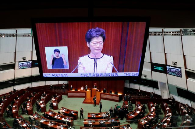 Hong Kong Chief Executive Carrie Lam is seen on a screen as she reacts to protests by pro-democracy lawmakers, at the Legislative Council in Hong Kong, China, October 16, 2019. REUTERS/Tyrone Siu