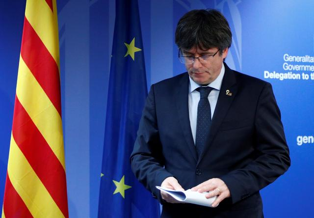 Former Catalan President Carles Puigdemont leaves after a news conference in Brussels, Belgium, after Spain's Supreme Court sentenced nine separatist leaders from Catalonia, October 14, 2019.  REUTERS/Francois Lenoir