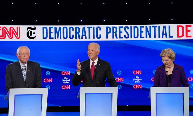 Democratic presidential candidate and former Vice President Joe Biden speaks as Senators Bernie Sanders and Elizabeth Warren listen during the fourth U.S. Democratic presidential candidates 2020 election debate at Otterbein University in Westerville, Ohio U.S., October 15, 2019. REUTERS/Shannon Stapleton