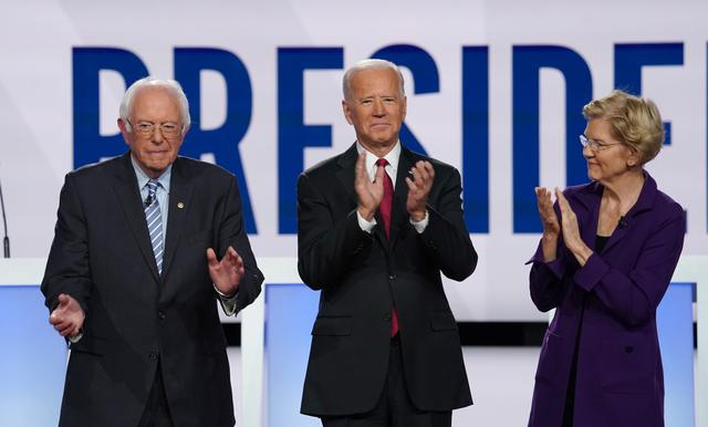 Democratic presidential candidates Senator Bernie Sanders, former Vice President Joe Biden and Senator Elizabeth Warren applaud as they pose together at the start of the fourth U.S. Democratic presidential candidates 2020 election debate in Westerville, Ohio, U.S., October 15, 2019. REUTERS/Shannon Stapleton