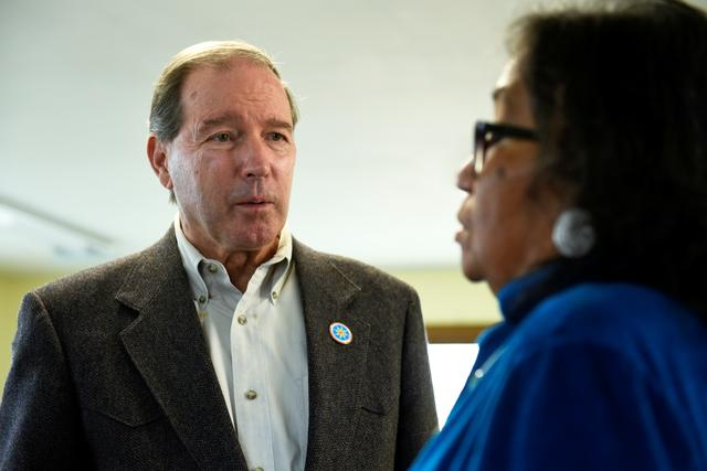 FILE PHOTO: U.S. Sen. Tom Udall (D-NM), visits with Phyliss Young, an organizer of the tribal get-out-the-vote coalition ahead of the 2018 mid-term elections on the Standing Rock Reservation in Fort Yates, North Dakota, U.S. October 26, 2018.  REUTERS/Dan Koeck