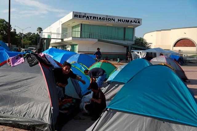 """Central American migrants are seen in an encampment in Matamoros, Mexico, at the end of the Gateway International Bridge, where migrants sent back under the """"Remain in Mexico"""" program, officially called the Migrant Protection Protocols (MPP), await their U.S. asylum hearings, September 14, 2019. Picture taken September 14, 2019. REUTERS/Henry Romero"""