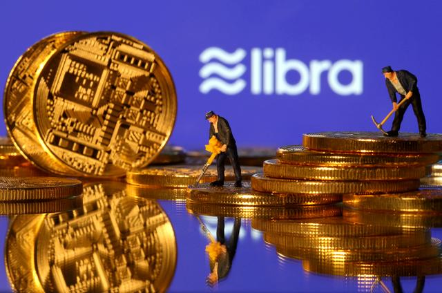 FILE PHOTO: Small toy figures are seen on representations of virtual currency in front of the Libra logo in this illustration picture, June 21, 2019. REUTERS/Dado Ruvic/File Photo/File Photo
