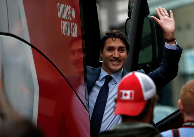 Liberal leader and Canadian Prime Minister Justin Trudeau waves after an interview at TVA studio as he campaigns for the upcoming election, in Montreal, Quebec, Canada October 16, 2019. REUTERS/Stephane Mahe