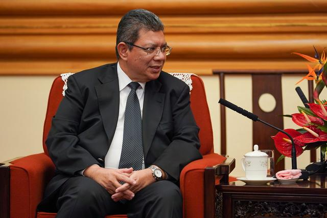 FILE PHOTO: Malaysian Foreign Minister Dato' Saifuddin Abdullah speaks with member of the Politburo of the Communist Party of China Yang Jiechi (not pictured) during a meeting in Beijing, China September 12, 2019. Andrea Verdelli/Pool via REUTERS