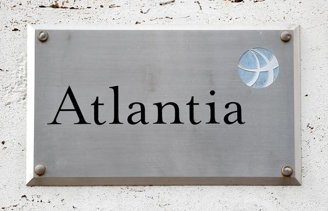 FILE PHOTO: A logo of the Atlantia Group is seen outside their headquarters in Rome, Italy August 31, 2018.  REUTERS/Alessandro Bianchi/File Photo