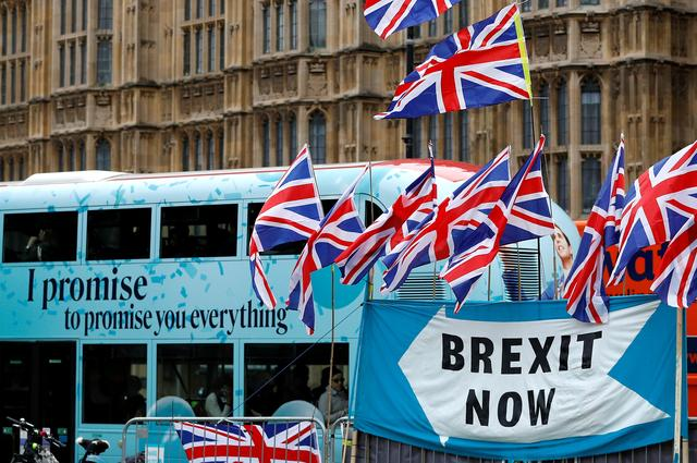 FILE PHOTO: A passenger bus passes a pro-Brexit demonstration in Westminster, London, Britain, September 30, 2019.  REUTERS/Peter Nicholls/File Photo