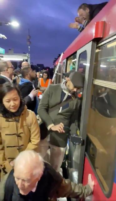 People look at Extinction Rebellion protesters glued onto the train at the Shadwell DLR station in London, Britain in this still image obtained from social media video dated October 17, 2019. TWITTER @MAXIMUS3005/via REUTERS