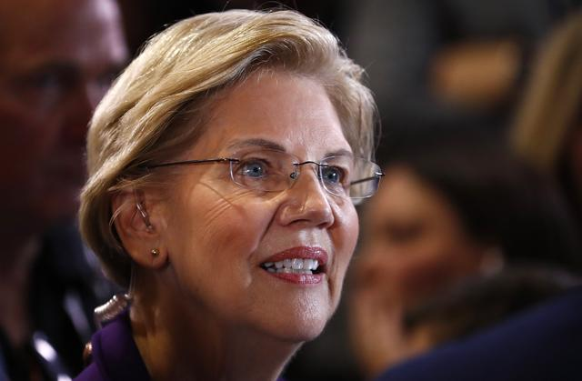 """Democratic presidential candidate Senator Elizabeth Warren does an interview in the """"Spin Room"""" after the conclusion of the fourth U.S. Democratic presidential candidates 2020 election debate at Otterbein University in Westerville, Ohio U.S., October 15, 2019. REUTERS/Aaron Josefczyk"""