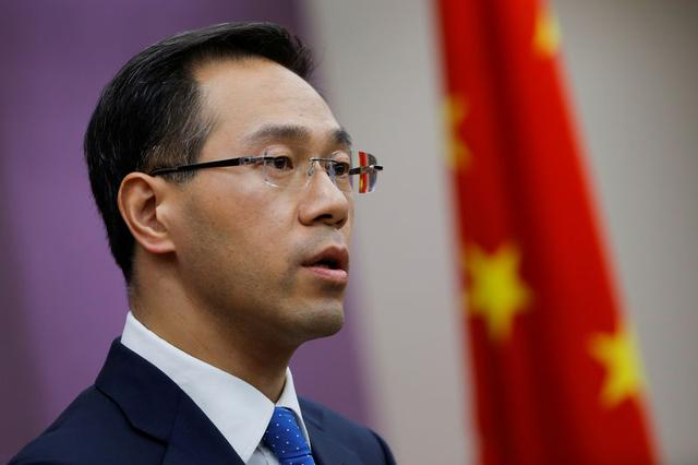 FILE PHOTO: China's Ministry of Commerce spokesperson Gao Feng attends a news conference in Beijing, China April 6, 2018. REUTERS/Thomas Peter/File Photo