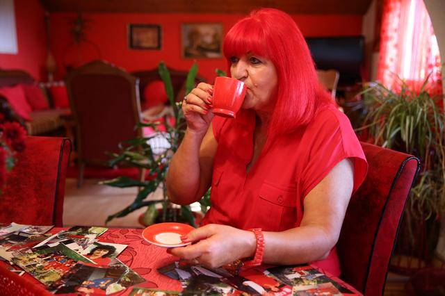Zorica Rebernik, obsessed with the red color, drinks coffee in her house in the village of Breze near Tuzla, Bosnia and Herzegovina October 16, 2019. REUTERS/Dado Ruvic