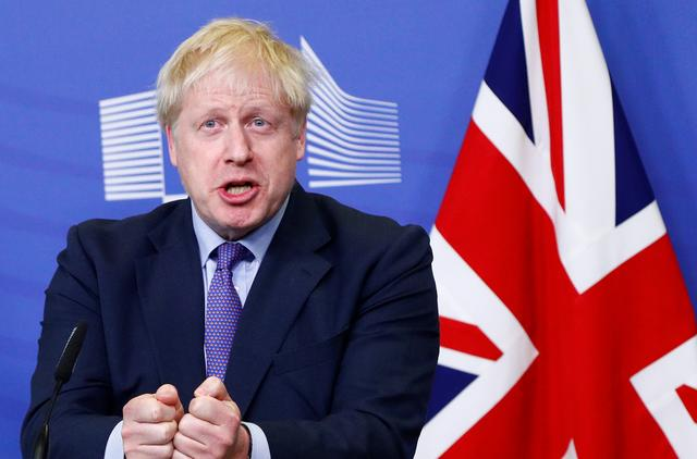 Britain's Prime Minister Boris Johnson gestures during a news conference with European Commission President Jean-Claude Juncker after agreeing on the Brexit deal, at the sidelines of the European Union leaders summit, in Brussels, Belgium October 17, 2019. REUTERS/Francois Lenoir