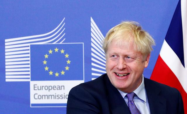 Britain's Prime Minister Boris Johnson smiles during a news conference with European Commission President Jean-Claude Juncker after agreeing on the Brexit deal, at the sidelines of the European Union leaders summit, in Brussels, Belgium October 17, 2019. REUTERS/Francois Lenoir