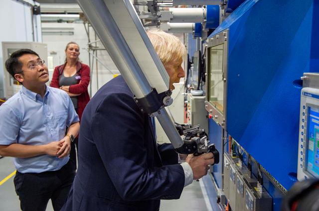 FILE PHOTO: Britain's Prime Minister Boris Johnson visits the Fusion Energy Research Centre at the Fulham Science Centre in Oxfordshire, Britain August 8, 2019. Julian Simmonds/Pool via REUTERS/File Photo
