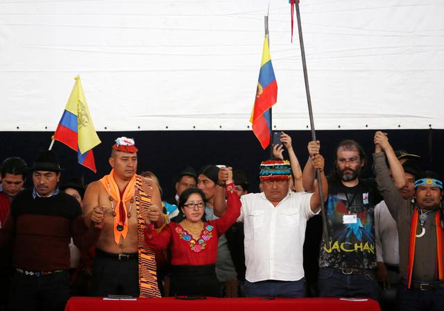 FILE PHOTO: Ecuadorean indigenous leader Jaime Vargas (3rd R) gestures with fellow leaders from different ethnic communities during a news conference in Quito, Ecuador, October 14, 2019. REUTERS/Daniel Tapia