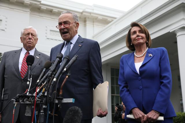 U.S. Senate Minority Leader Chuck Schumer (D-NY) speaks to reporters with House Majority Leader Steny Hoyer (D-MD) and House Speaker Nancy Pelosi (D-CA) after meeting with U.S. President Donald Trump at the White House in Washington, U.S., October 16, 2019.  REUTERS/Leah Millis