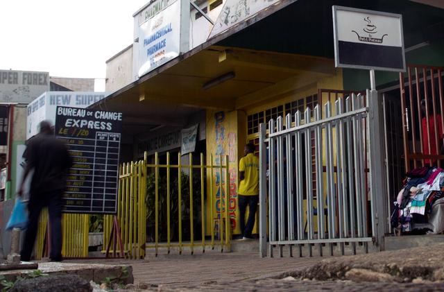 Pedestrians walk along a deserted verandah where black market forex dealers operated before a currency market crackdown in Bujumbura, Burundi, October 17, 2019. REUTERS/Evrard Ngendakumana