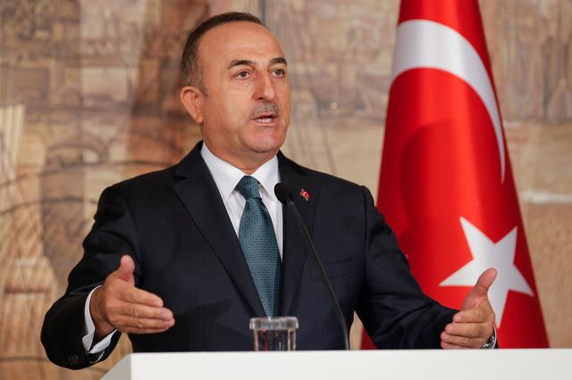 FILE PHOTO: Turkish Foreign Minister Mevlut Cavusoglu attends a news conference in Istanbul, Turkey, October 11, 2019. REUTERS/Huseyin Aldemir