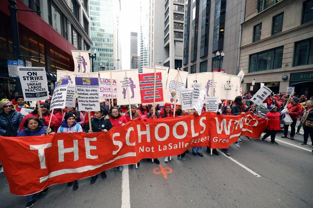 Teachers protest during a rally on the first day of a teacher strike in Chicago, Illinois, U.S., October 17, 2019.  REUTERS/John Gress