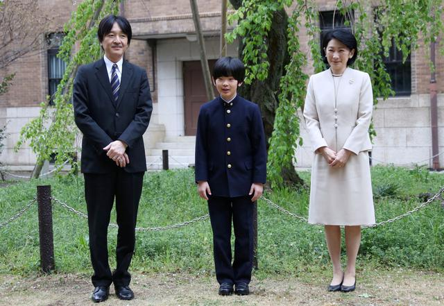 FILE PHOTO: Prince Hisahito, accompanied by his parents Prince Akishino and Princess Kiko, poses for photos at Ochanomizu University junior high school before attending the entrance ceremony in Tokyo, Japan April 8, 2019. Koji Sasahara/Pool via Reuters/File Photo