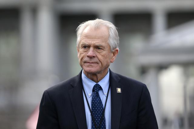 FILE PHOTO: White House trade adviser Peter Navarro listens to a news conference about a presidential executive order relating to military veterans outside of the West Wing of the White House in Washington, U.S. March 4, 2019. REUTERS/Leah Millis/File Photo