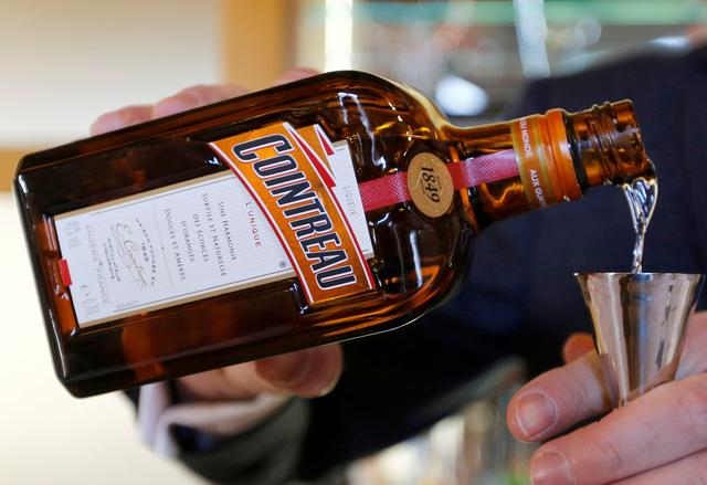 FILE PHOTO: A man pours Remy Cointreau into a glass at the Remy Martin factory in Cognac, France, November 21, 2018. REUTERS/Regis Duvignau/File Photo
