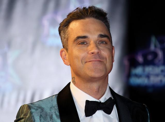 FILE PHOTO: Singer Robbie Williams arrives to attend the NRJ Music Awards ceremony at the Festival Palace in Cannes, France, November 12, 2016. REUTERS/Eric Gaillard