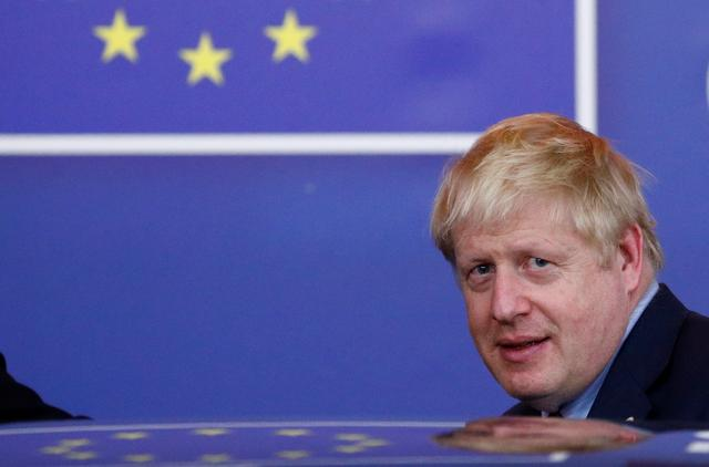 Britain's Prime Minister Boris Johnson leaves the European Council after the Brexit-dominated European Union leaders summit in Brussels, Belgium October 18, 2019. REUTERS/Francois Lenoir