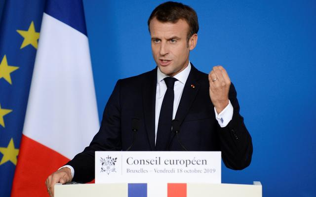 French President Emmanuel Macron gestures as he holds a news conference at the end of the European Union leaders summit dominated by Brexit, in Brussels, Belgium October 18, 2019. REUTERS/Johanna Geron