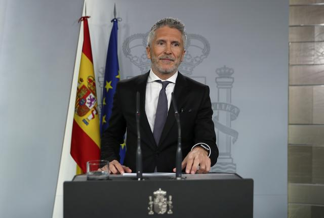 FILE PHOTO: Spain's Interior Minister Fernando Grande-Marlaska speaks during a news conference at Moncloa Palace in Madrid, Spain, October 17, 2019. REUTERS/Sergio Perez