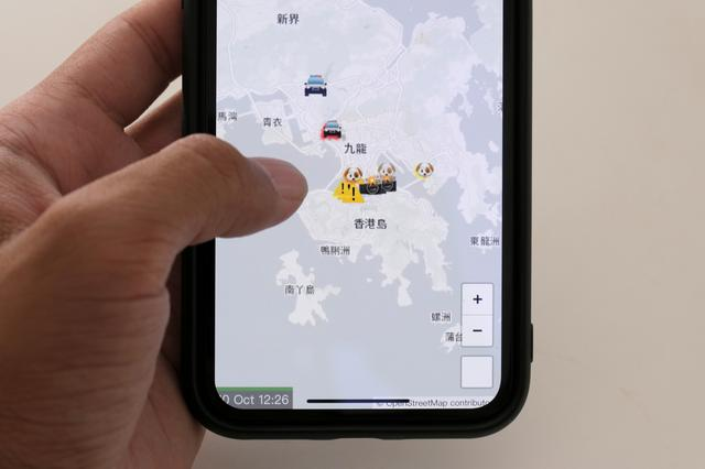 FILE PHOTO: The HKmap.live App is pictured on a phone screen in this photo illustration, in Hong Kong, China, October 10, 2019. REUTERS/Tyrone Siu