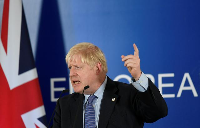 FILE PHOTO: Britain's Prime Minister Boris Johnson speaks during a news conference at the European Union leaders summit dominated by Brexit, in Brussels, Belgium October 17, 2019. REUTERS/Piroschka van de Wouw