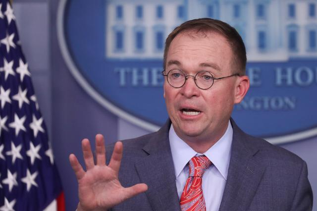 FILE PHOTO: Acting White House Chief of Staff Mick Mulvaney addresses reporters during a news briefing at the White House in Washington, U.S., October 17, 2019. REUTERS/Leah Millis/File Photo
