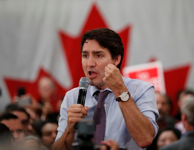 Liberal leader and Canadian Prime Minister Justin Trudeau takes part in a rally as he campaigns for the upcoming election,, in Vaughan, Ontario, Canada October 18, 2019. REUTERS/Stephane Mahe