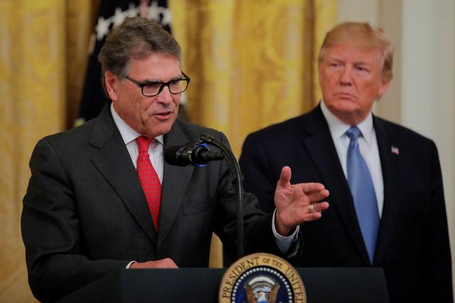 FILE PHOTO: U.S. President Donald Trump listens to U.S. Energy Secretary Rick Perry speak during an event touting the administration's environmental policy in the East Room of the White House in Washington, U.S., July 8, 2019. REUTERS/Carlos Barria/File Photo