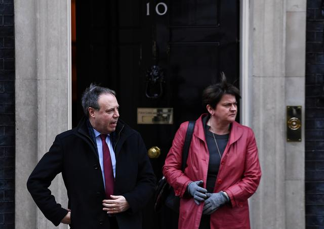FILE PHOTO: Democratic Unionist Party leader Arlene Foster and Nigel Dodds leave in Downing Street, London, Britain, January 17, 2019. REUTERS/Clodagh Kilcoyne