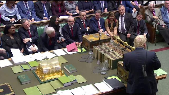 Britain's opposition Labour Party Leader Jeremy Corbyn listens as Britain's Prime Minister Boris Johnson speaks at the House of Commons as parliament discusses Brexit, sitting on a Saturday for the first time since the 1982 Falklands War, in London, Britain, October 19, 2019, in this screen grab taken from video. Parliament TV via REUTERS