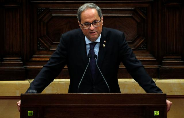 FILE PHOTO: Catalan leader Quim Torra addresses the regional parliament after Spain's Supreme Court jailed nine separatist leaders, triggering violent protests in the region, in Barcelona, Spain, October 17, 2019. REUTERS/Albert Gea