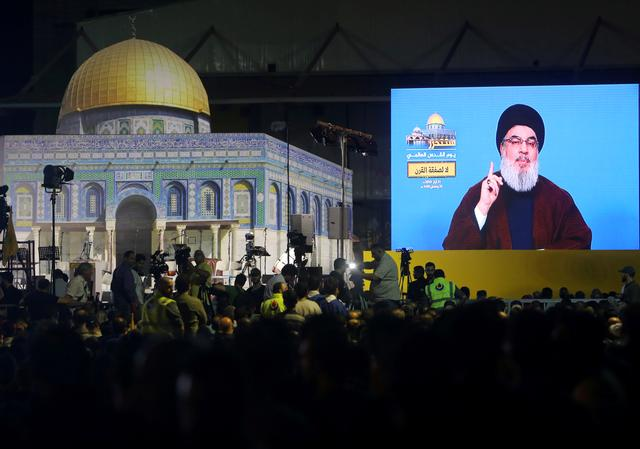 FILE PHOTO: Lebanon's Hezbollah leader Sayyed Hassan Nasrallah addresses his supporters via a screen during a rally marking al-Quds Day, (Jerusalem Day) in Beirut, Lebanon May 31, 2019. REUTERS/Aziz Taher