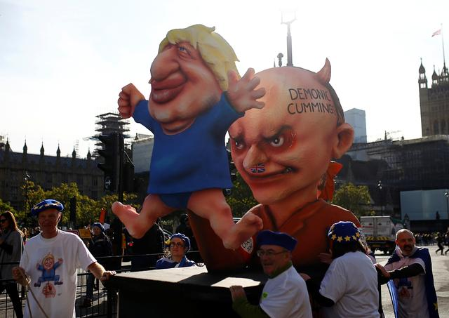 Figures depicting Britain's Prime Minister Boris Johnson and his special advisor Dominic Cummings are displayed during a demonstration as parliament sits on a Saturday for the first time since the 1982 Falklands War, to discuss Brexit in London, Britain, October 19, 2019. REUTERS/Henry Nicholls