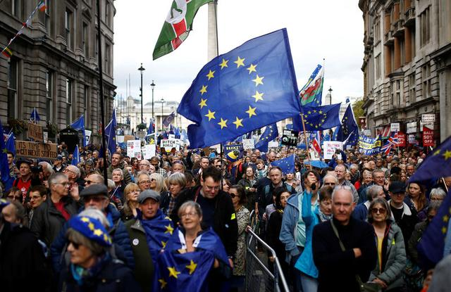 EU supporters march as parliament sits on a Saturday for the first time since the 1982 Falklands War, to discuss Brexit in London, Britain, October 19, 2019. REUTERS/Henry Nicholls