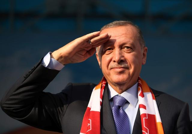 Turkish President Tayyip Erdogan salutes during a gathering in Kayseri, Turkey, October 19, 2019. Mustafa Kamaci/Presidential Press Office/Handout via REUTERS