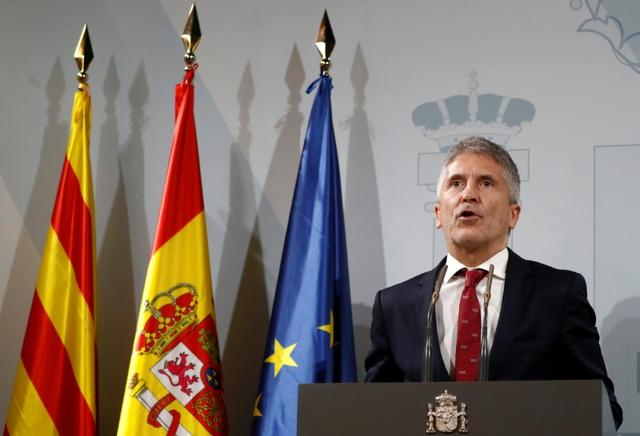 Spain's acting Interior Minister Fernando Grande-Marlaska speaks at a news conference after holding meeting with police commanders in charge of the police operation in Catalonia, in Barcelona, Spain, October 19, 2019. REUTERS/Jon Nazca